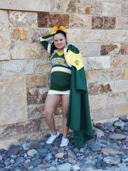 Haley Parra, 18, is a senior at Mayfield High School. Parra has been on the Mayfield varsity cheer team for four years.