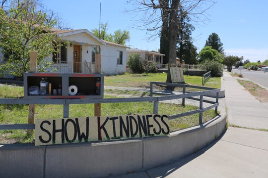 Las Cruces resident Amy Whipple put up a community cupboard in her yard at the corner of Boutz Road and Chapparo Street, to help neighbors in need. On Monday March 30, 2020, Whipple said people have started donating small things and also taking needed items.