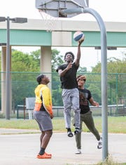 From left, Omir Wallace, Marlon Jarvis and Oneal Daniels play basketball at Hollice T. Williams Sr. Park in Pensacola on Monday.