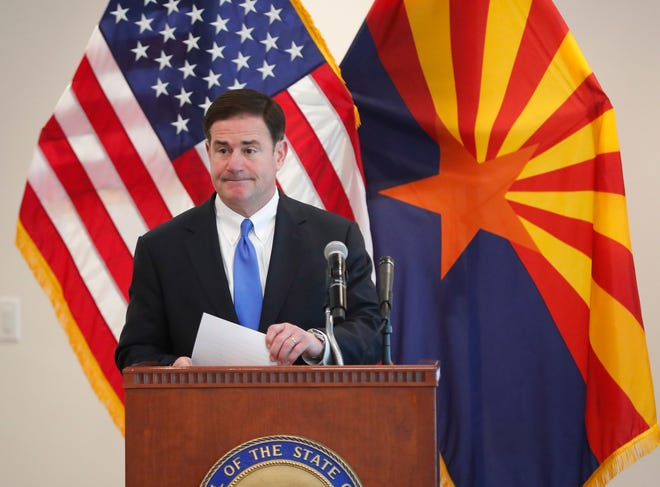Gov. Doug Ducey fields a question on COVID-19 during a news conference at the Arizona Commerce Authority in Phoenix March 30, 2020. Gov. Ducey issued a stay at home order effective close of business March 31.