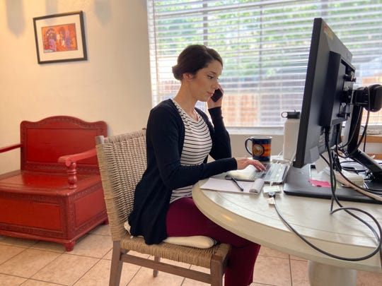 Kelsey Gifford, a constituent affairs representative for Sen. Kyrsten Sinema, D-Ariz., helps constituents from home.