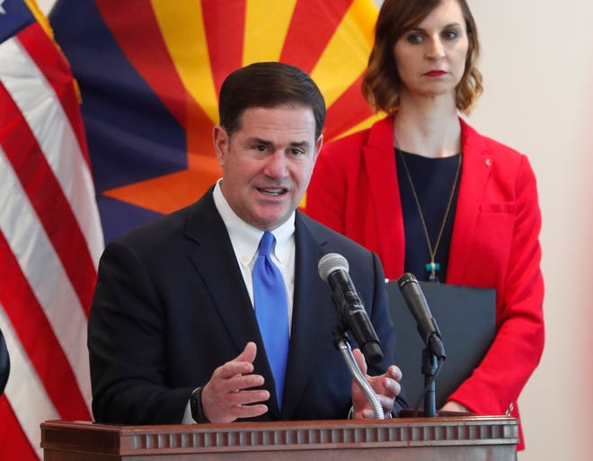 Gov. Doug Ducey answers questions on COVID-19 during a news conference at the Arizona Commerce Authority in Phoenix March 30, 2020. Gov. Ducey issued a stay at home order effective close of business March 31. Superintendent of Public Instruction Kathy Hoffman is at right.