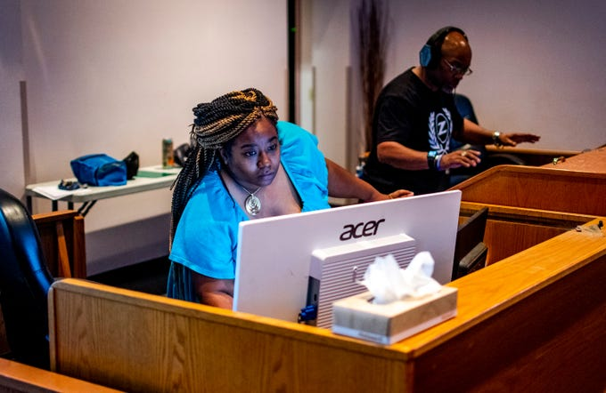 Tracy Lewis, Director of Communications, Marketing and Media at the church, works on the live stream during the Sunday service at First Institutional Baptist Church in Phoenix on March 29, 2020.