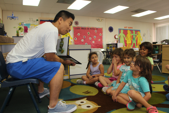 Future Kiddie's Ken Chan leads a circle time computer lesson for students at Grace Garden Preschool in Ahwatukee Foothills.