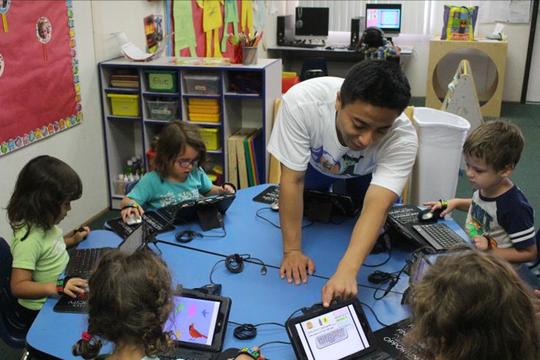Future Kiddie's Ken Chan teaches computer skills to students at Grace Garden Preschool in Ahwatukee Foothills.