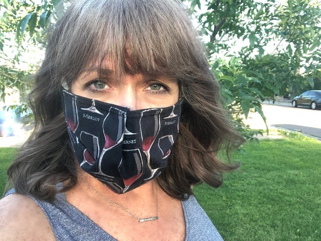 My friend Lesley Hooser, who's a nurse, made this mask for me. I pop it on when I'm at the grocery store and people aren't keeping their distance.