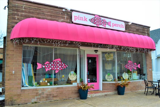 Kim Redfern lit up her downtown Marblehead shop, the Pink Perch, with pink lights as part of the Light Up the Night Ottawa County event.