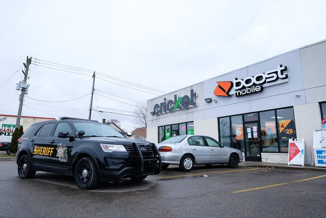 Police are searching for two suspects after an armed robbery at Boost Mobile in Port Huron Township  Monday afternoon.