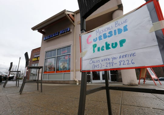 Signs for curbside pickup from Mexicali Blue in Wappingers Falls on March 30, 2020.