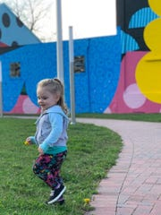 Reagan Schwartzbeck, 1, plays outside while under the care of Amy Jo Yost Family Daycare.