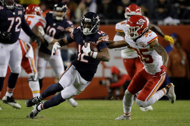 Chicago Bears wide receiver Allen Robinson (12) runs after a catch against the Kansas City Chiefs in the second half of an NFL football game in Chicago, Sunday, Dec. 22, 2019. (AP Photo/Nam Y. Huh)