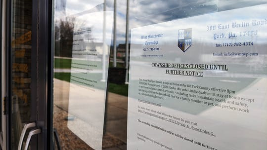 A sign on the West Manchester Township office alerts visitors that the township office is closed until further notice due to the stay-at-home order.