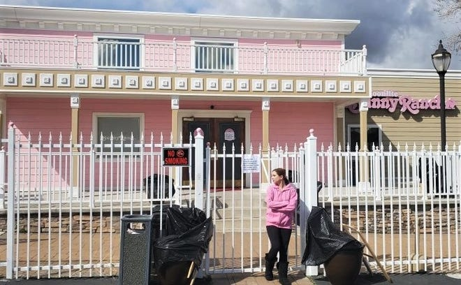 In this 2020 photo, Nevada sex worker Alice Little stands outside the closed Bunny Ranch brothel.
