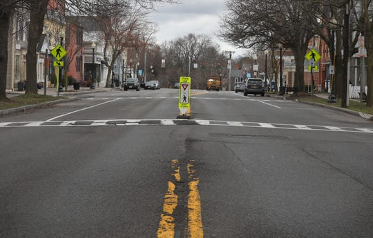Looking northward up S. Main Street into the heart of the village of Pittsford at 3 pm Monday, March 30, 2020. Normally, this same stretch is busy with cars and school busses dropping off students at the end of a school day. Due to the coronavirus pandemic, these are not normal days.