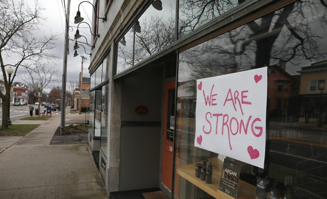 A sign in the window of closed Salon Industry, at 30 S. Main Street, provides hope in the village of Pittsford Monday, March 30, 2020. Most of the small businesses the line the main street are closed due to the coronavirus pandemic.