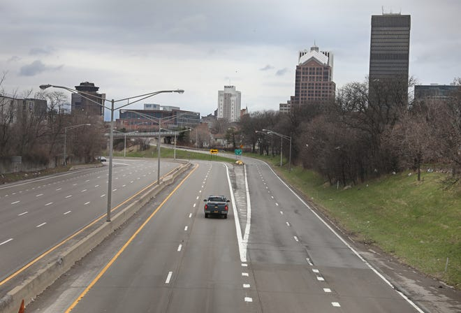 The morning rush of commuter traffic into downtown Rochester on Route 490 heading west is quiet at 9 am on Monday morning, March 30, 2020. The national stay-at-home order was extended until April 30th keeping most workers at home.