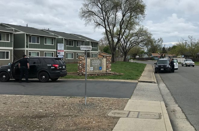 Anderson police positioned themselves outside an apartment complex after they received a report of shots fired. It turned out to be a false alarm.