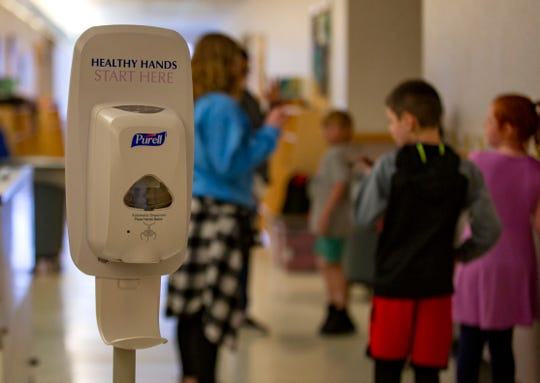 Children line up to wash their hands before lunchtime at the East Lancaster Community Center in Salem on March 30, 2020. The program, usually for pre-school aged children, has extended their age range up to 12 years old.