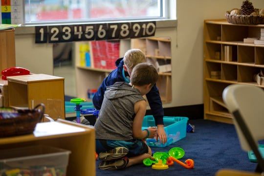 Children play at the East Lancaster Community Center in Salem on March 30, 2020. The program, usually for pre-school aged children, has extended their age range up to 12 years old.