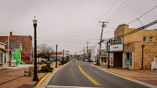 The usually bustling Main Street in Chincoteague is deserted Sunday, March 29, as town officials closed all visitor accommodations.