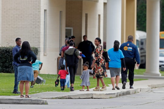 Congregants arrive at the Life Tabernacle Church in Central,  Sunday, March 29, 2020. Pastor Tony Spell has defied a shelter-in-place order by Louisiana Gov. John Bel Edwards, due to the new coronavirus pandemic, and continues to hold church services with hundreds of congregants.