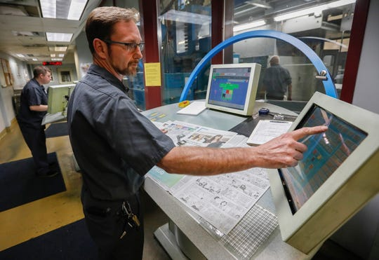 Jason Shull, press room supervisor, makes adjustments during the final press run on the Springfield News-Leader's press on Sunday, March 29, 2020. Printing operations for the News-Leader have been moved to Columbia, Mo.