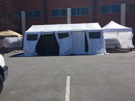 As part of Augusta Health's regular emergency management drills, they practice setting up triage tents outside the emergency department. This year, the tents will remain in place in preparation for an influx of patients with coronavirus COVID-19 illness.