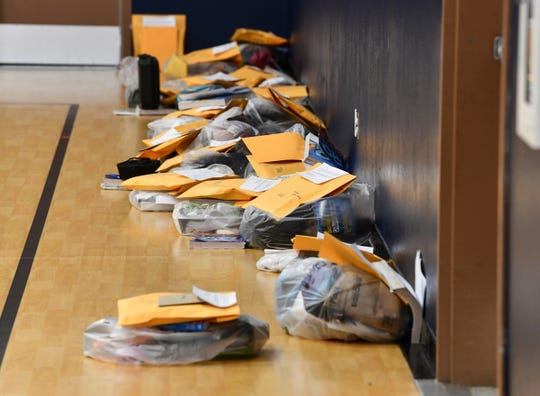Schoolwork packets and other items are ready for distribution to students and their families Monday, March 30, 2020, at STRIDE Academy in St. Cloud.