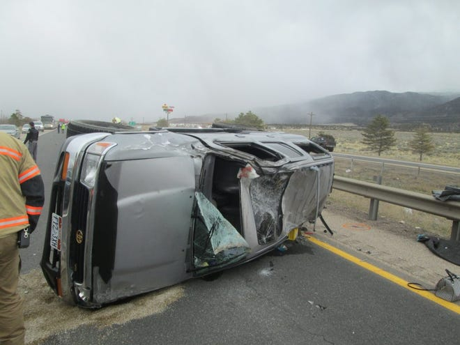 Emergency responders evaluate the scene of a rollover on Interstate 15 north of Cedar City where a 3-year-old child was ejected and killed on Sunday, March 29.