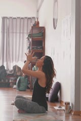 Yoga instructor Aimee Carrillo is teaching classes live on Instagram during the stay-at-home order.