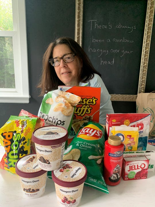 Charin Freundlich of Rye Brook with some of the junk food now in her house.