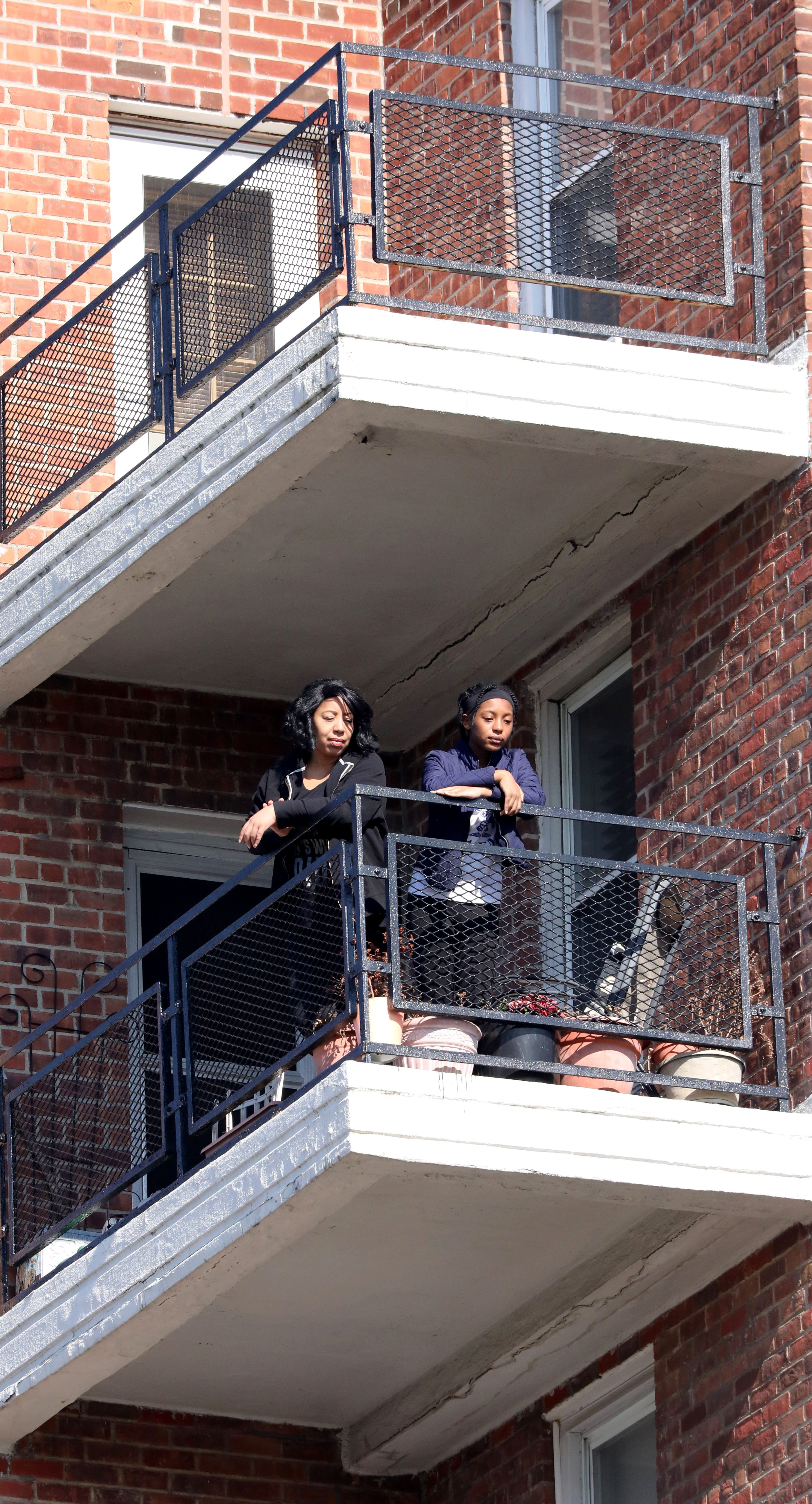 Patrice Sullivan and her daughter Janelle, 14, are focused on the way forward: stopping at nothing to achieve their dreams. They're shown here getting fresh air outside their Yonkers co-op apartment.