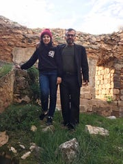 In this March 12, 2020 photo made available by Reem Mousa, Ismail Mousa and his daughter Anisa of Selbyville, Delaware, pose for a photograph while sightseeing near the Palestinian village of Qaryout in the West Bank. Mousa and his daughter found themselves stranded and separated from each other after their travels plans and efforts to return home were thwarted because of the coronavirus pandemic.