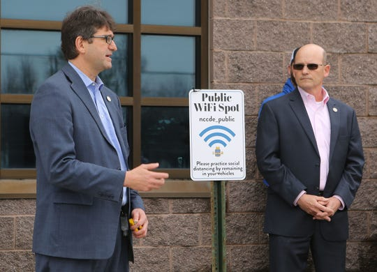 New Castle County Executive Matt Meyer (left) and Michael Hojnicki, Chief of Technology for New Castle County talk about establishing Wi-Fi hotspots at the Garfield Park PAL and seven other locations in the county.