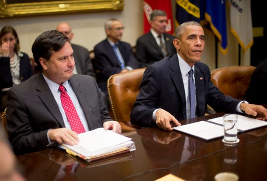 President Barack Obama meets with his National Security and Public Health teams to receive an update on the Ebola response, Tuesday, Nov. 18, 2014, in the Roosevelt Room of the White House in Washington. At left is Ebola Response Coordinator Ron Klain.