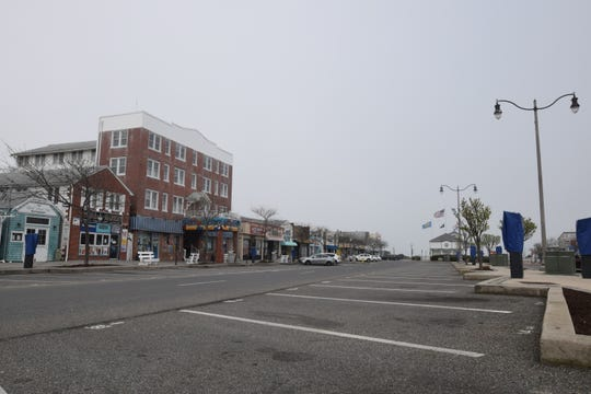 Rehoboth Avenue in Rehoboth Beach was eerily empty on Monday, the first day out-of-state visitors were ordered to quarantine if they decide to visit Delaware during the coronavirus outbreak.