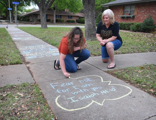 Haley Woolsey and her mother, Julie Woolsey, started a series of sidewalk chalk messages to lift and encourage people walking by in their neighborhood. They also put out containers of extra chalk for anyone to add their own.