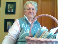 Susan shows some of the sympathy cards that came to Sunnybook Farm after Bob's passing.