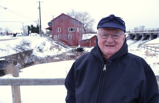 Jerry standing by the old mill in Wild Rose. NPR Photo.