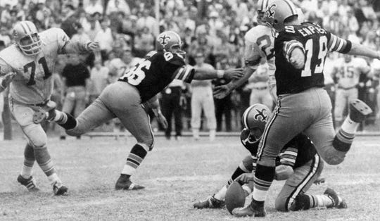 New Orleans Saints kicker Tom Dempsey connects on an NFL record 63-yard field goal on Nov. 8, 1970, in a game against the Detroit Lions