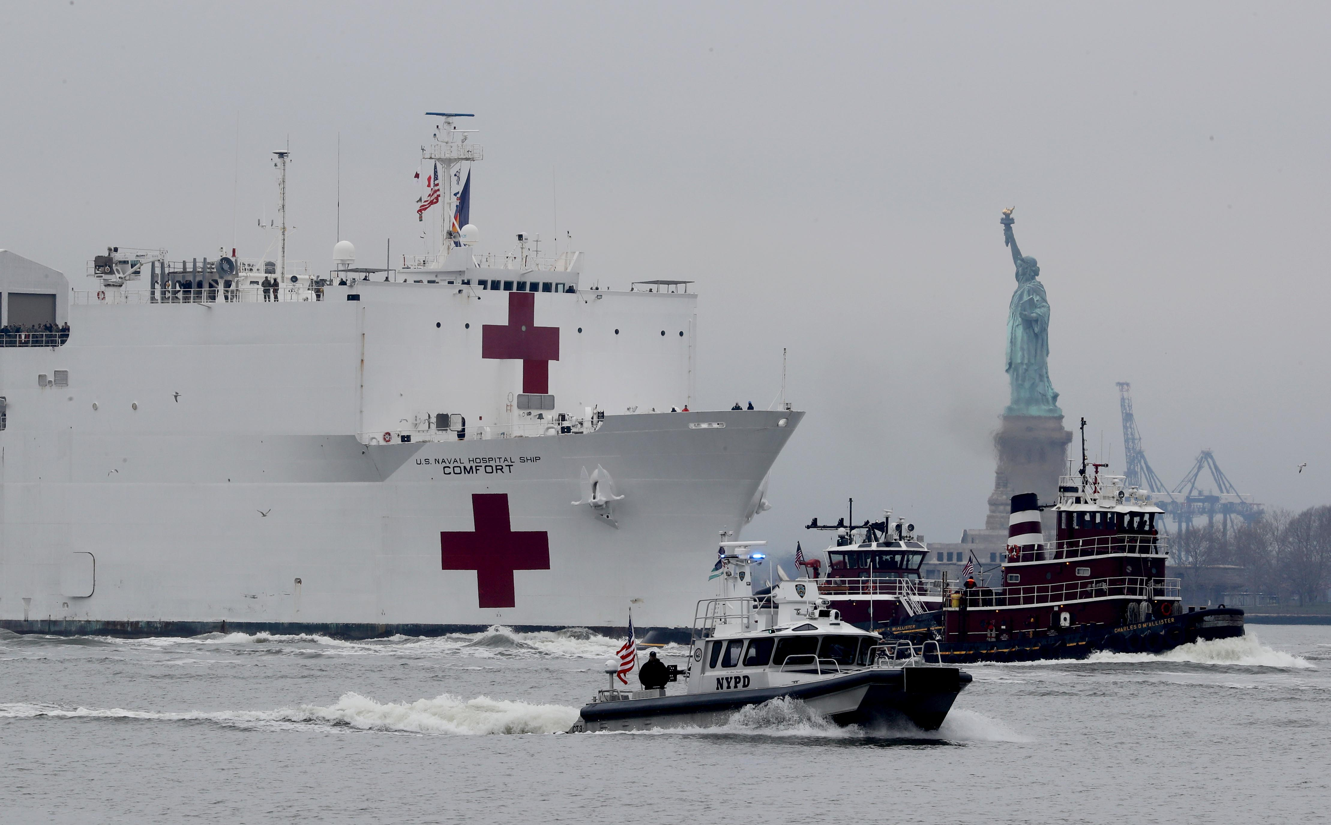 Coronavirus live updates: USNS Comfort arrives in NYC; Anthony Fauci defends extension of social distancing rules