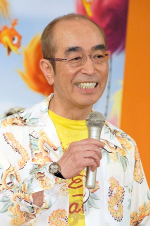 In this September 2012, photo, Japanese comedian Ken Shimura speaks during a campaign for an animation film in Tokyo. The nationally popular Japanese comedian, who said was drawing inspired from Jerry Lewis,  has died of the COVID-19 pneumonia, a first known celebrity victim of the virus in Japan. He was 70.