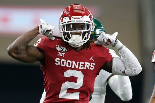 Oklahoma Sooners wide receiver CeeDee Lamb celebrates during the 2019 Big 12 Championship Game against Baylor at AT&T Stadium, the home of the NFL team that just drafted him -- the Dallas Cowboys.