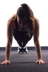 Showing excellent form at the start of a push up.