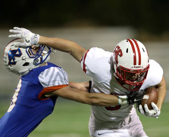 Kimberly's Tyler Verstegen (right) looks to get past Appleton West's Blake Pahlow during a Valley Football Association-North game on Sept. 30, 2016, in Appleton. The Papermakers won the game 45-14 to set a new state record for consecutive victories at 49 straight.