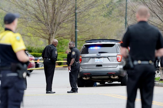 Sheriff Quentin Miller, left, talks to an officer at the scene of a shooting outside Asheville City Hall March 31, 2020. The suspected shooter was killed in the altercation and a sheriff's office lieutenant sustained non-life threatening injuries.