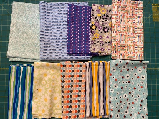 "Desiree Bray‎, the administrator of the ""Face masks for Broome County"" Facebook group, purchased fabric for group members to use to make masks."