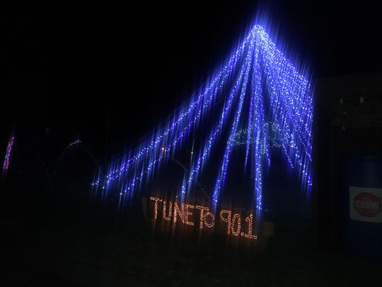 The Mabee family's display, on the corner of Ford and Glenwood Roads in Vestal, features its popular light up tree with 72 strands of lights.