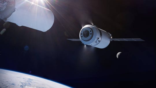 Illustration of the SpaceX Dragon XL as it is deployed from the Falcon Heavy on its way to the Gateway in lunar orbit.