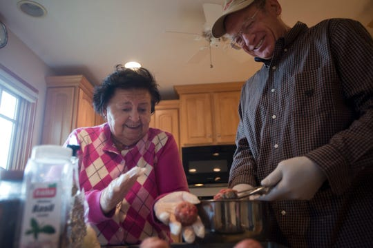 Mary Anne Gucciardi, left, makes meatballs with John Varricchione, a longtime member of Burlington area Italian community, at John's home on April 29, 2013.